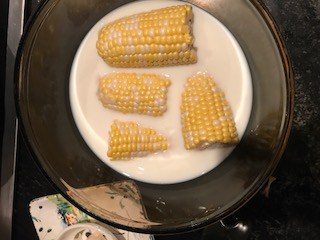 Corn cobs soaking in milk make the corn sweeter
