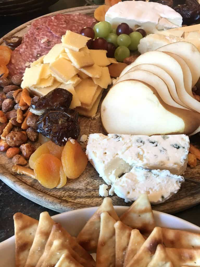 Bleu cheese, dried apricots, sliced pears, cubed white cheddar on a cheeseboard