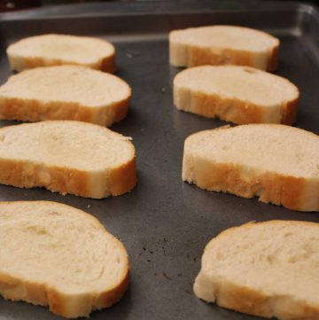 French Bread Slices on Baking Sheet