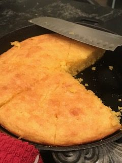 Cornbread in skillet with knife