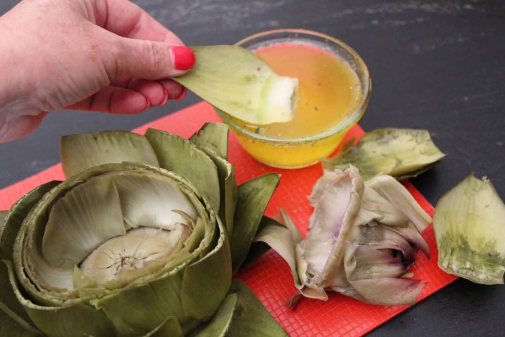 Artichoke dipped in clarified butter