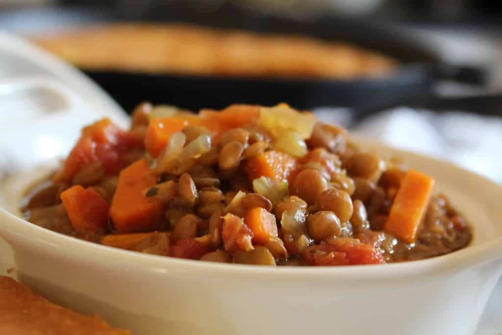 Close up image of lentil soup in white bowl