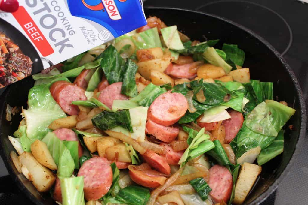 Cabbage, sausage, potatoes and onion in cast iron skillet