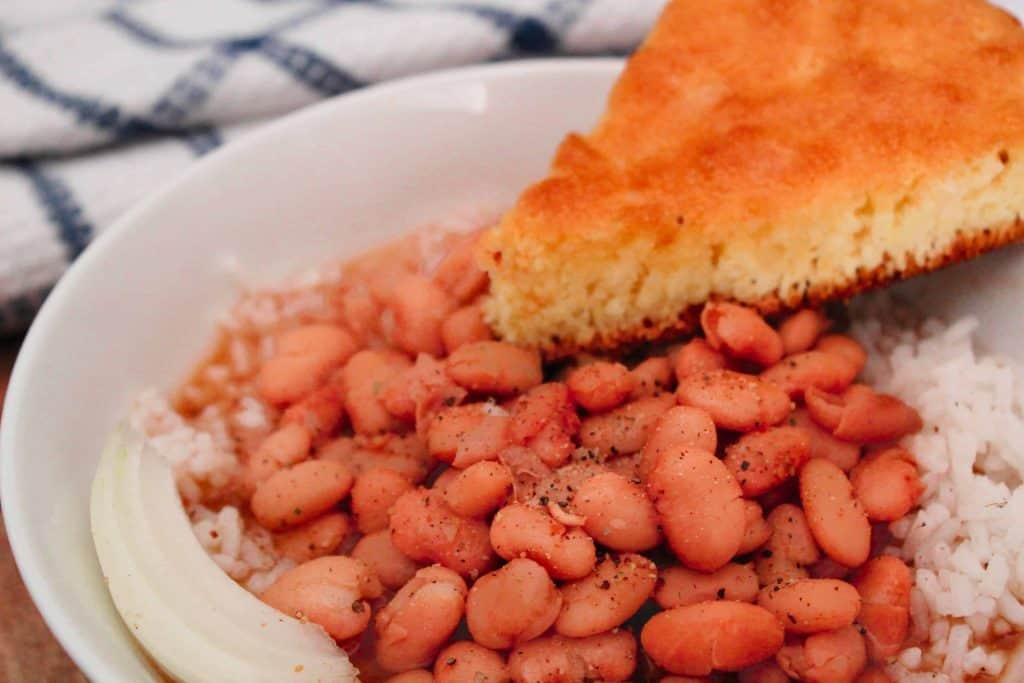 Rice and Beans with a slice of cornbread in a bowl