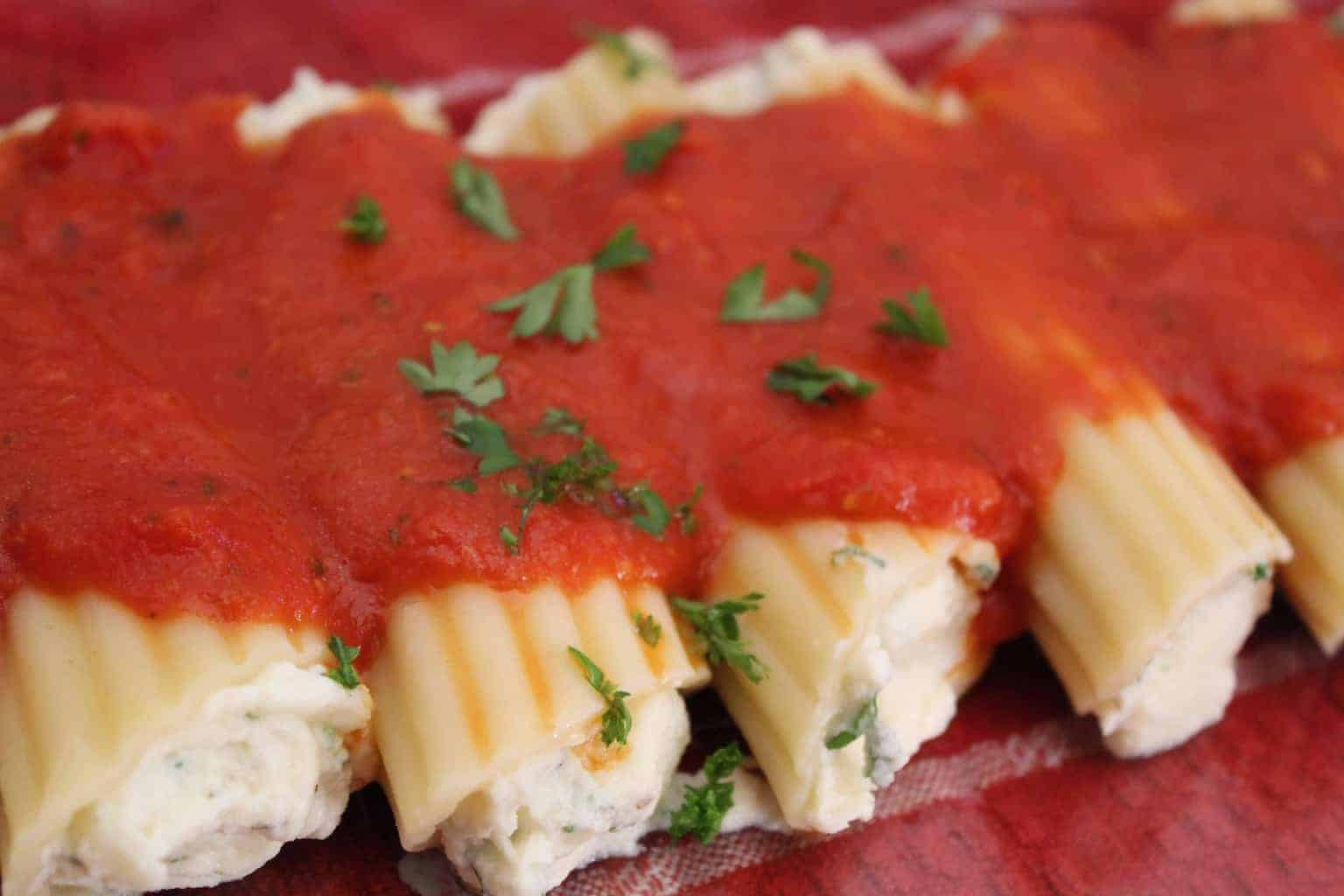 Manicotti shells stuffed with savory ricotta and mozzarella cheeses, topped with San Marzano pasta sauce