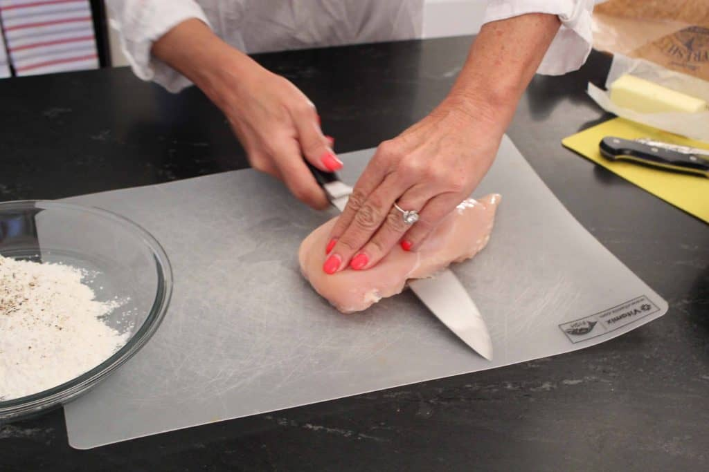 Slice chicken breast in half lengthwise for chicken piccata