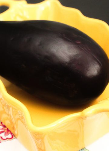 Wjp;e Eggplant in a yellow rectangular baking dish
