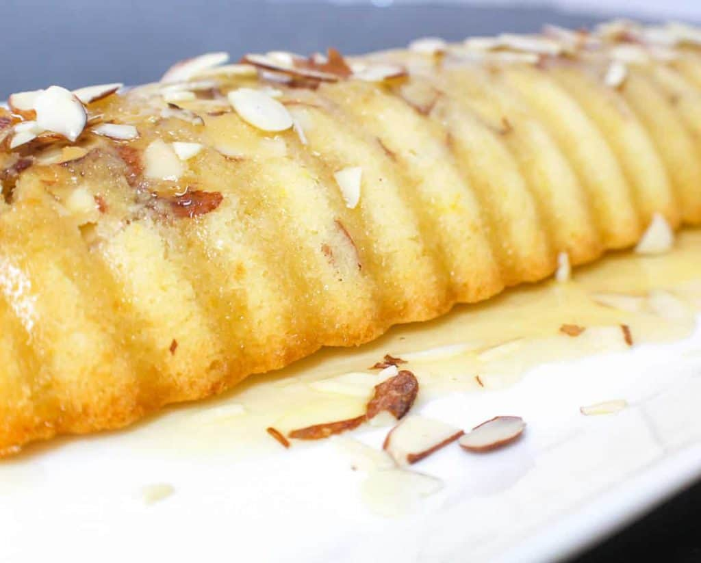 Rum Glazed Scandinavian Almond Cake on platter