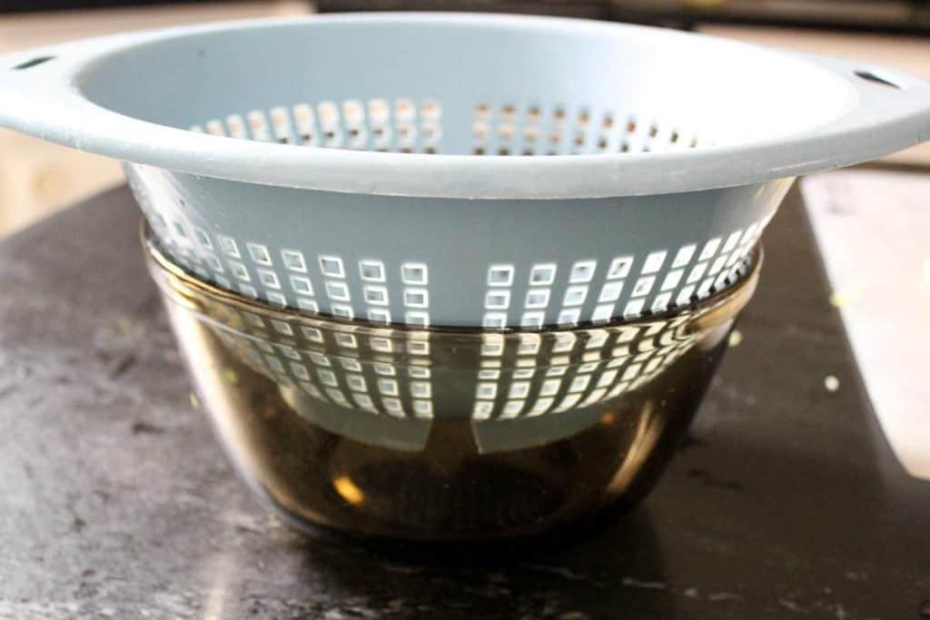 Colander to reserve water for creamy vegan potato leek soup