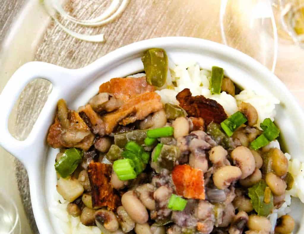 White bowl of easy Hoppin' John served over white rice