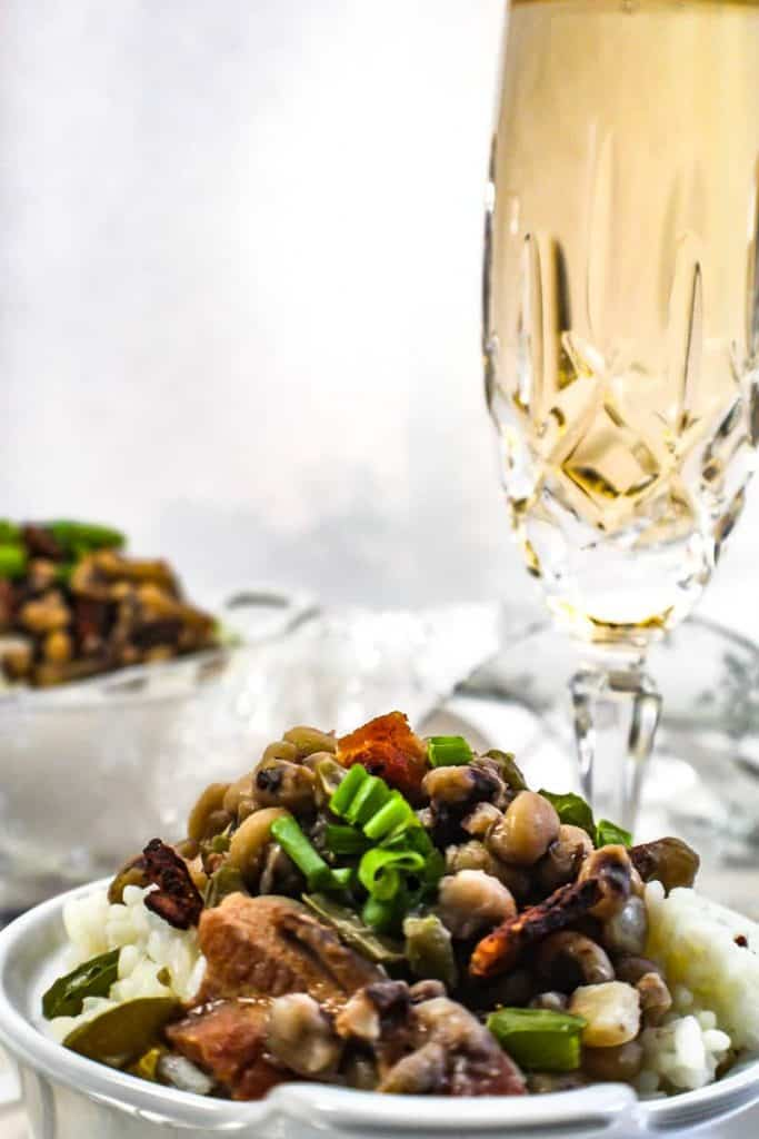 Bowl of hoppin' john and a glass of champagne