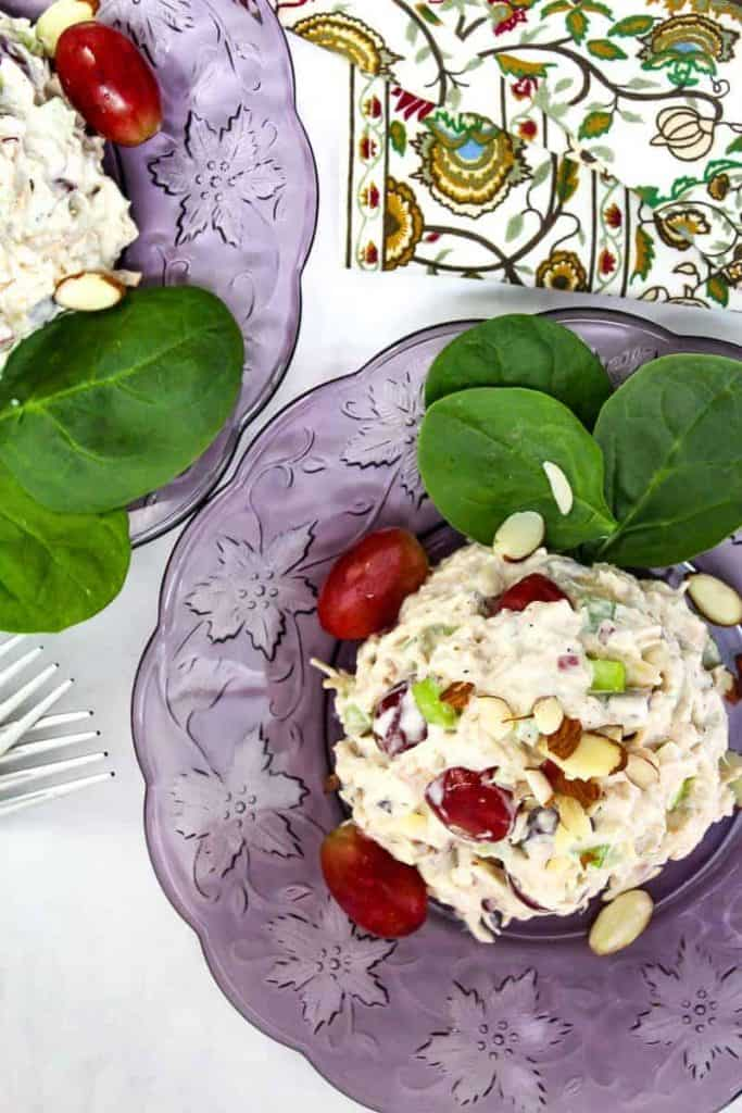 Leftover Turkey Salad with red grapes on a purple plate