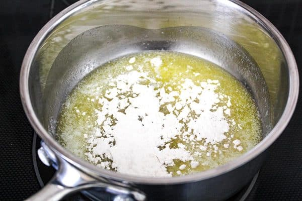 Melted butter with flour sprinkled in saucepan