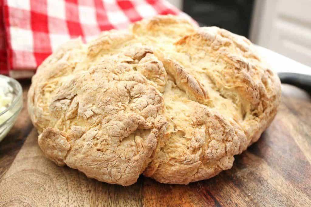 Artisan loaf of Irish Soda Bread shaped in a puffed disc