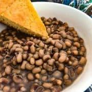 Purple Hull peas and cornbread in bowl