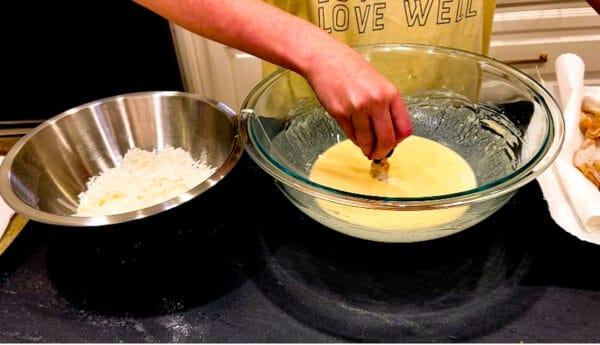 Shrimp being dipped in batter