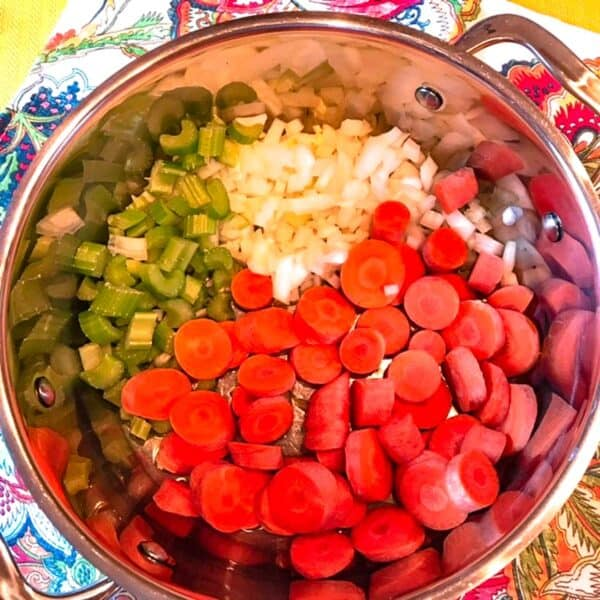Onions, carrots and celery in stockpot